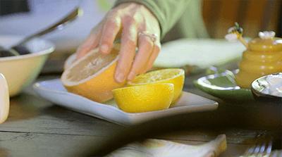 holding grapefruit half