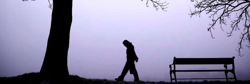 lonely person walking in winter