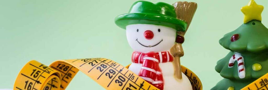 santa figurine and measuring tape