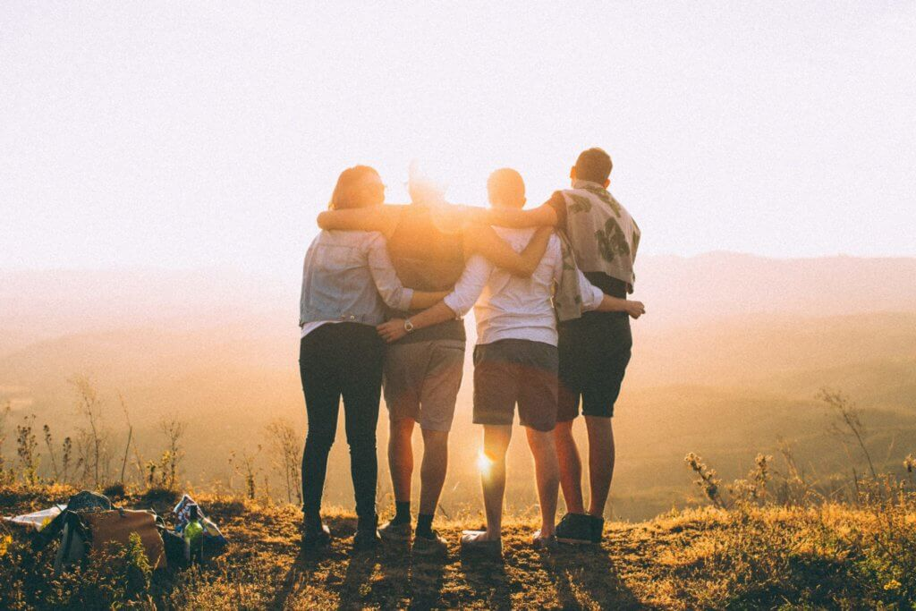 Group hugging on mountaintop